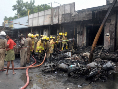 Fire fighters try to douse the fire at the godown containing crackers in Sivakasi in Tamil Nadu on Thursday. PTI