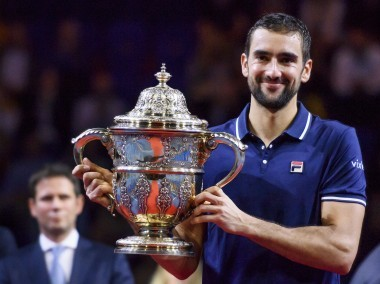 Marin Cilic poses with the trophy after winning the final against Kei Nishikori. AFP