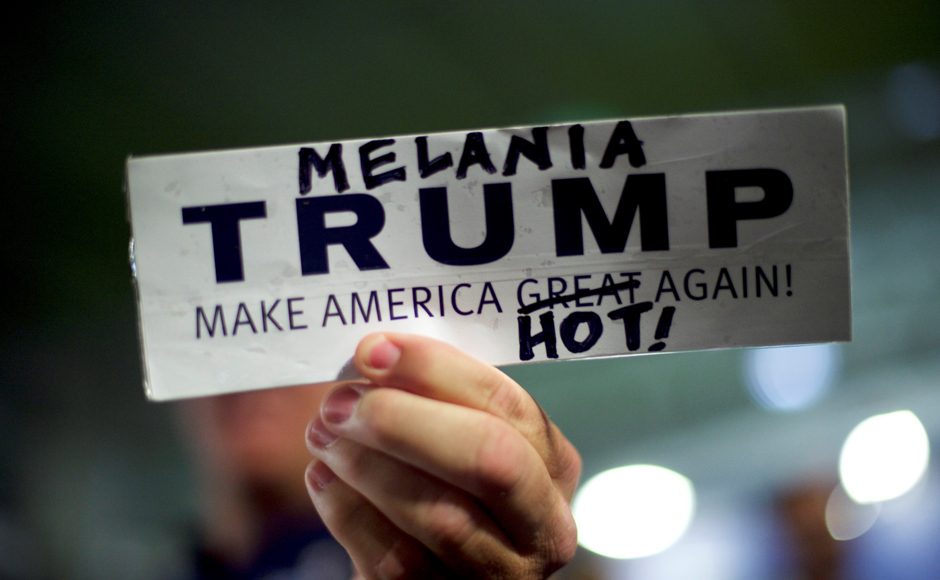 A Donald Trump supporter holds a modified campaign bumper sticker in favor of Melania Trump, wife to the Republican Presidential nominee Donald Trump, who spoke during an event at Main Line Sports in Berwyn, Pennsylvania November 3, 2016. Reuters