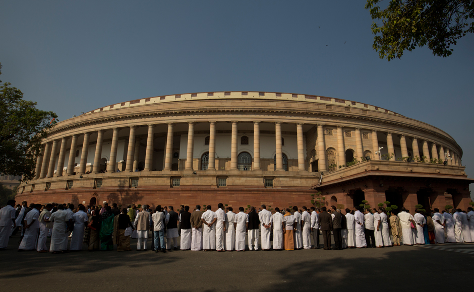 """Opposition parties on Wednesday came together to protest against demonetisation outside Parliament, with Congress vice-president Rahul Gandhi describing it as the world's """"biggest impromptu financial experiment"""" and said they are firm on their demand for a JPC probe into the """"scam"""". Parties form a human chain outside the parliament building during the protest. (Photo: AP)"""