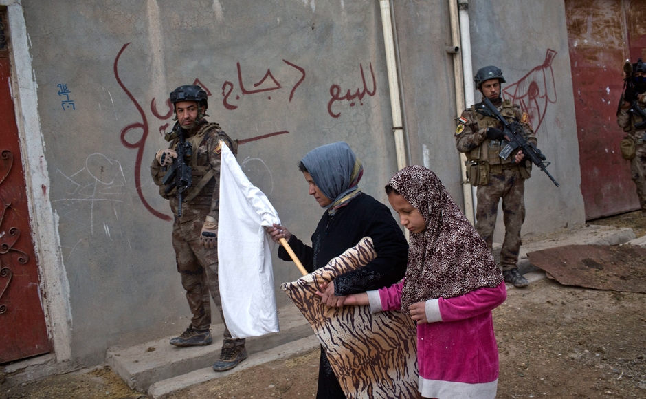 The Islamic State group is forcibly gathering people in and around Mosul for possible use as human shields against advancing Iraqi forces, said residents, confirming UN fears. AP