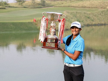 Aditi Ashok poses with the Hero Women's Indian Open Golf trophy. PTI