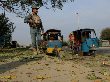 An Afghan policeman stands guard at the site of blast in Jalalabad city, Afghanistan on Thursday. Reuters