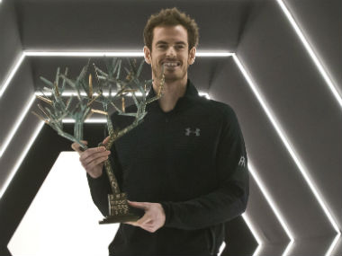 Andy Murray poses with the trophy after winning the Paris Masters. AP