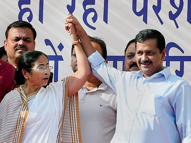 Delhi Chief Minister Arvind Kejriwal and West Bengal Chief Minister Mamata Banerjee join hands at a mass rally against demonetisation of currency notes in New Delhi. PTI