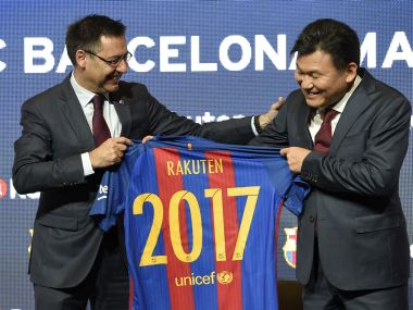 Barcelona's president and CEO of Japanese company Rakuten display FC Barcelona's new jersey. AFP