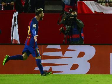 Lionel Messi (L) and Luis Suarez (R) scored for Barcelona. AFP