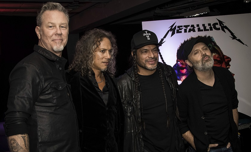 Metallica, (from left) James Hetfield, Kirk Hammett, Robert Trujillo and Lars Ulrich pose for photographers during a photo call before signing copies of the new album in London. AP