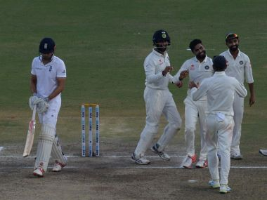 India's Ravindra Jadeja celebrates as England captain Alastair Cook is dismissed on the last ball of the day. AFP