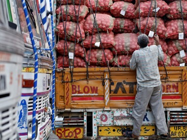 A labourer prepares to unload sacks of potatoes from a truck at a wholesale vegetable and fruit market in New Delhi July 2, 2014. REUTERS/Anindito Mukherjee/File Photo - RTSM8GG