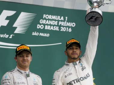 Lewis Hamilton's (R) win ensured the title race will go down to the wire. AP