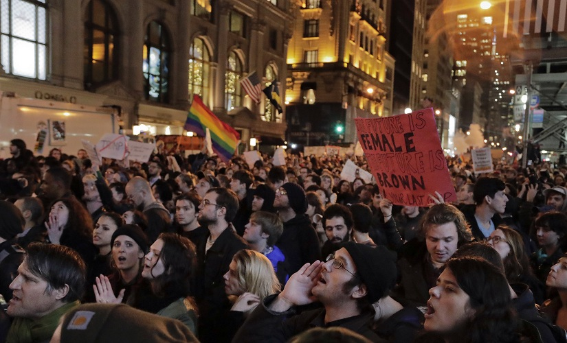 Protesters chant slogans on Fifth Avenue outside Trump Tower, Wednesday, Nov. 9, 2016, in New York, in opposition of Donald Trump's presidential election victory. (AP Photo/Julie Jacobson)