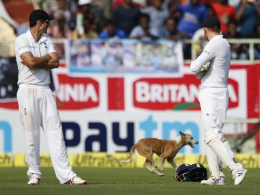 Alastair Cook and Jonny Bairstow watch a dog running into the field. AP