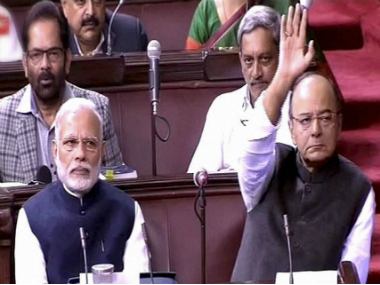 Prime Minister Narendra Modi and Finance Minister Arun Jaitley during a Rajya Sabha proceeding on Thursday. PTI