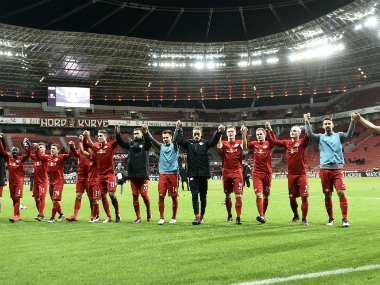 The Leipzig players celebrate reaching the top of the Bundesliga table. AP