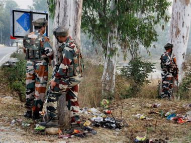 Security personnel take positions during a gun battle with suspected militants at the Army camp in Nagrota in Jammu. PTI