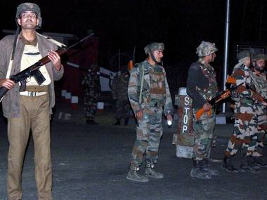 Security personnel after an encounter with millitants at Army camp in Nagrota. PTI