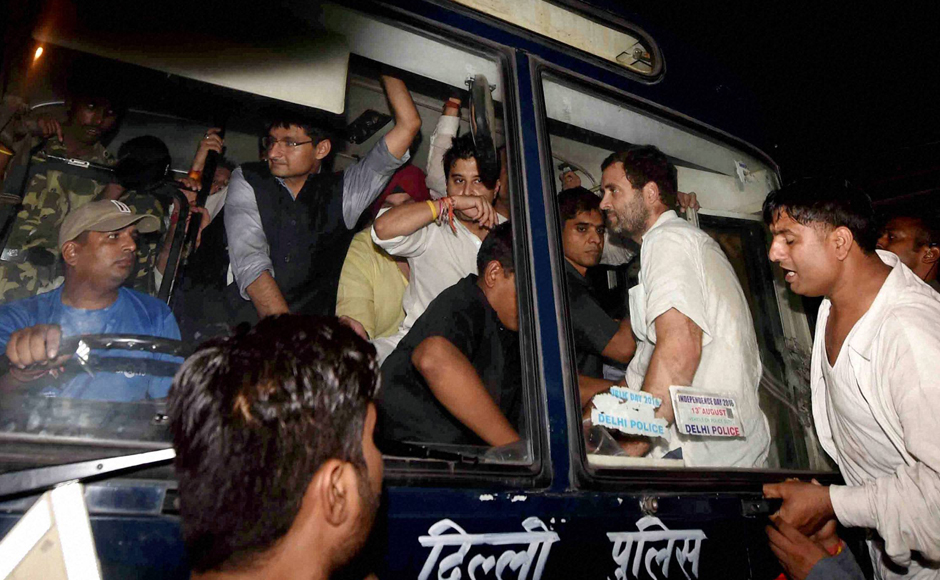 Congress vice-president Rahul Gandhi along with party leaders Jyotiraditya Scindia and Deepender Hooda being carried in a police bus from Parliament Street Police Station in New Delhi on Wednesday. Gandhi was earlier detained after he tried to meet family members of a retired army soldier Ram Kishan Grewal who allegedly committed suicide over One Rank, One Pension scheme. (Photo: PTI)