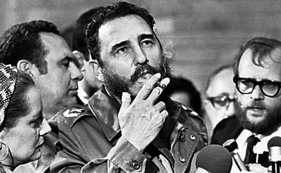 Guerrilla revolutionary and communist idol, Fidel Castro, smokes a cigar during interviews with the press in Havana during a visit of US Senator Charles McGovern in May 1975. Castro was a holdout against history who turned tiny Cuba into a thorn in the paw of the mighty capitalist United States. The former Cuban president, who died aged 90 on Friday, said he would never retire from politics. Reuters