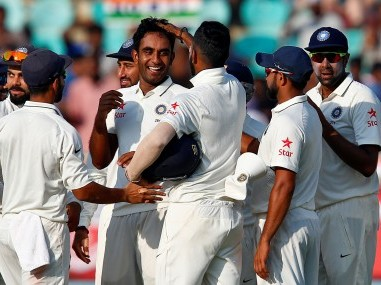 India's Jayant Yadav celebrates with team mates the dismissal of England's Moeen Ali. Reuters