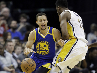 Golden State Warriors' Stephen Curry (L) during the match against Indiana Pacers. AP