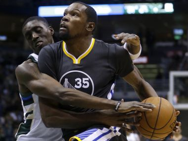 Golden State Warriors' Kevin Durant is fouled by Milwaukee Bucks' Tony Snell. AP
