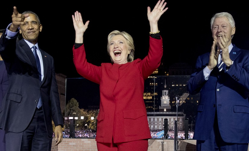 Democratic presidential candidate Hillary Clinton, center, is joined on stage by President Barack Obama left, and former President Bill Clinton, right, after speaking at a rally at Independence Mall in Philadelphia. AP