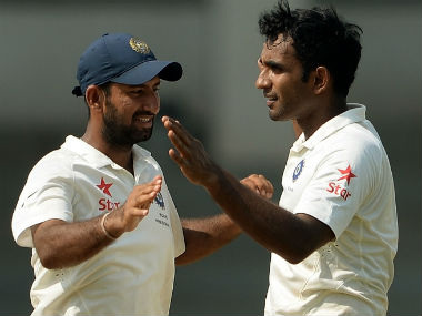 Jayant Yadav (R) celebrates with Cheteshwar Pujara during a tour match against the visiting South Africa in 2015. AFP