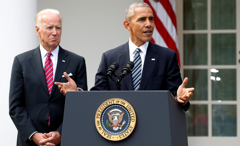 US President Barack Obama, with Vice President Joe Biden at his side, speaks about the election results. Reuters