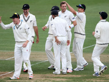 Tim Southee (C) celebrates with teammates after taking the wicket of Younis Khan on Day 2 of the 2nd Test. AFP