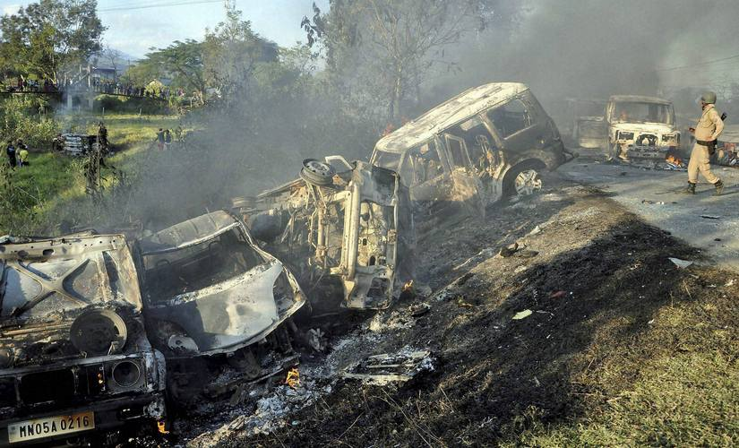 Remains of torched vehicles in imphal west as tension between valley and hill populace flared up following a blockade imposed by a naga group. PTI
