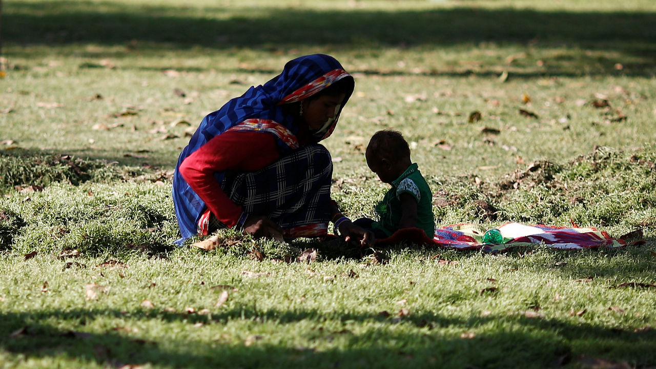 On the outskirts of New Delhi, women bear the highest cost