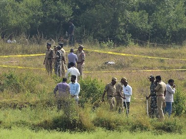 Policemen stand guard the area where four accused in the rape-and-murder case of a 25-year-old woman veterinarian were shot dead by police. PTI