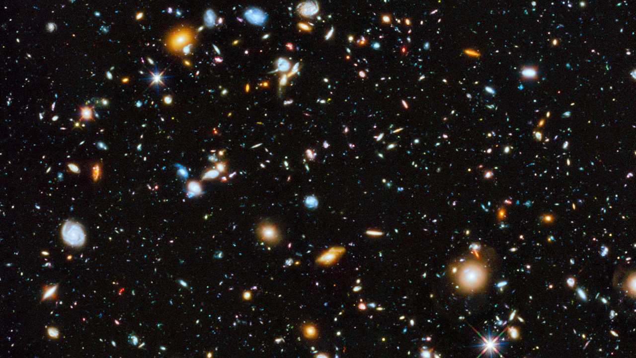 Astronomers using the Hubble Space Telescope have captured the most comprehensive picture ever assembled of the evolving Universe — and one of the most colourful. The study is called the Ultraviolet Coverage of the Hubble Ultra Deep Field (UVUDF) project. Image credit: ESA/Hubble