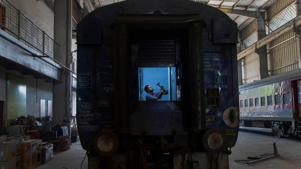 "An Indian railway employee works to convert a train coach into an isolation ward for the fight against the new coronavirus in Gauhati, India, Sunday, March 29, 2020. Indian Prime Minister Narendra Modi apologized to the public on Sunday for imposing a three-week national lockdown, calling it harsh but ""needed to win"" the battle against the coronavirus pandemic. The new coronavirus causes mild or moderate symptoms for most people, but for some, especially older adults and people with existing health problems, it can cause more severe illness or death. (AP Photo/Anupam Nath)"