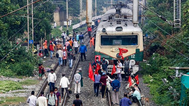 Activists of different parties block a railway track in Kolkata during a nationwide strike called by various trade unions on Thursday. AP