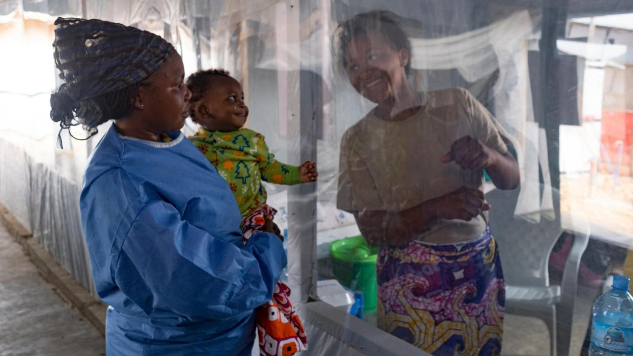 A plastic sheet separates 5 month-old Guerrishon from his mother, Collette, who is a patient at an Ebola Treatment Centre in Beni, North Kivu province. Image credit: UNICEF