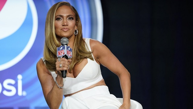 In this 30 Jan, 2020 file photo, NFL Super Bowl 54 football game halftime performer Jennifer Lopez answers questions at a news conference in Miami. Lopez will give a musical performance on the West Front of the US Capitol when Biden is sworn in as the nation's 46th president next Wednesday. (AP Photo/David J. Phillip)
