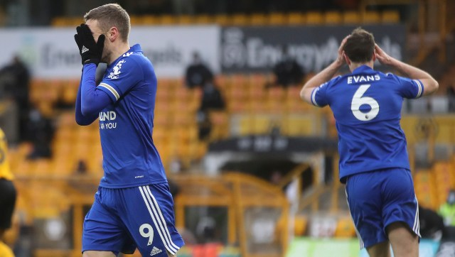 Leicester City's Jamie Vardy and Jonny Evans react during a match against Wolves. AP