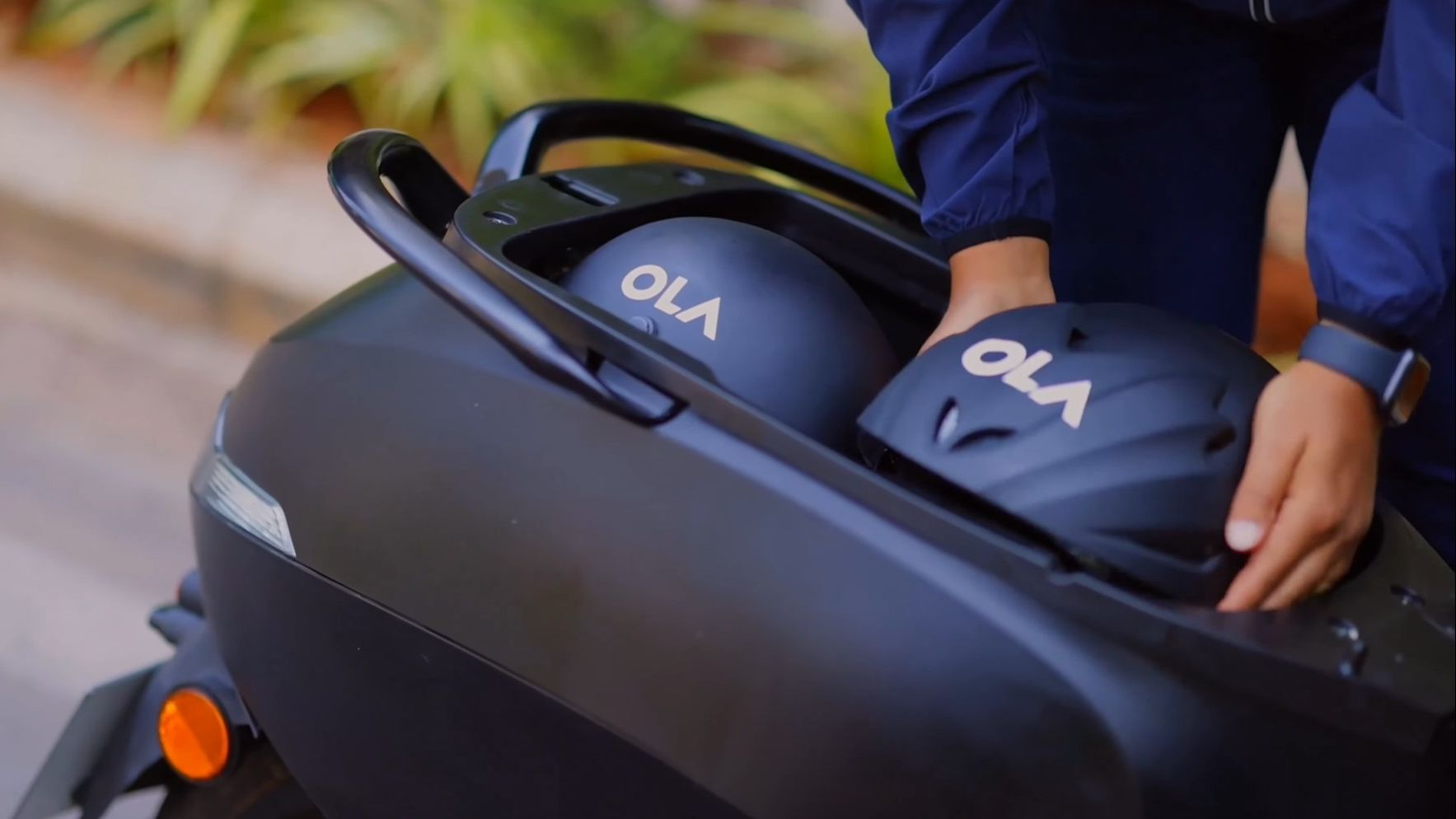 The Ola electric scooter can store two half-face helmets in its under-seat storage bay. Image: Ola Electric